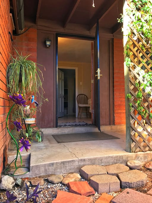 Your private entrance is shaded by your private porch and leafy trellis.
