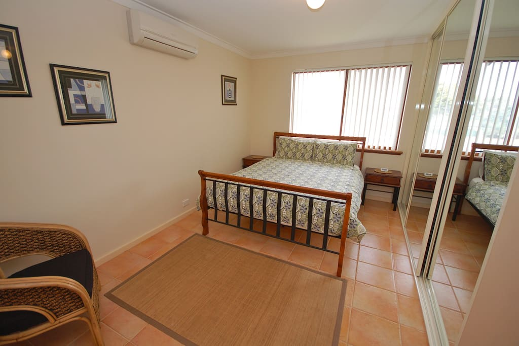 Main Bedroom with queen size bed and aircon.