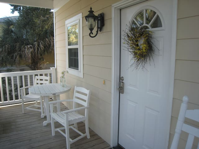 Welcoming front porch with a table and rockers.
