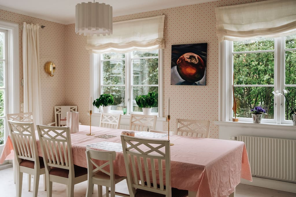 very spacious and bright dining room with French doors out onto the terrace