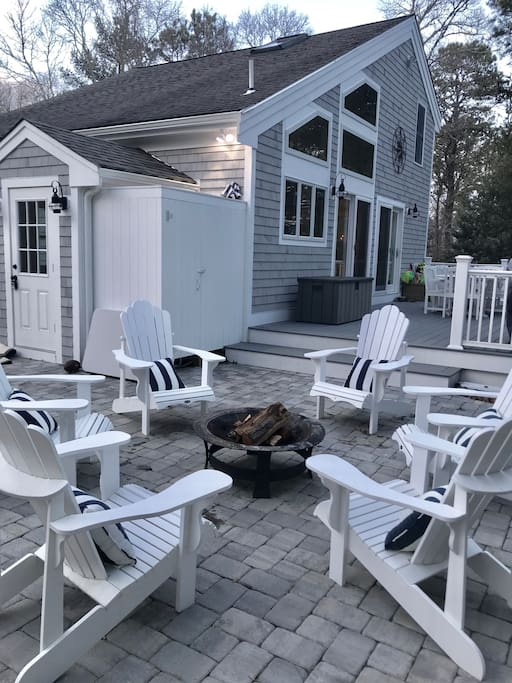 Patio w/firepit, deck, outdoor shower, and access to basement.