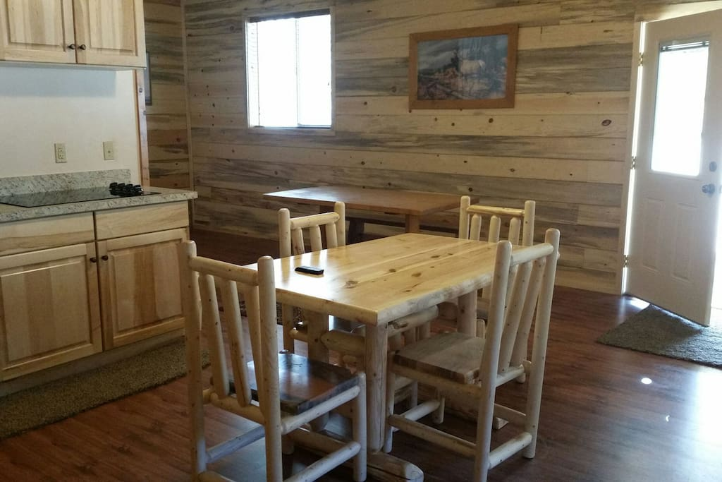 Well stocked cupboards-dining table with 4 chairs