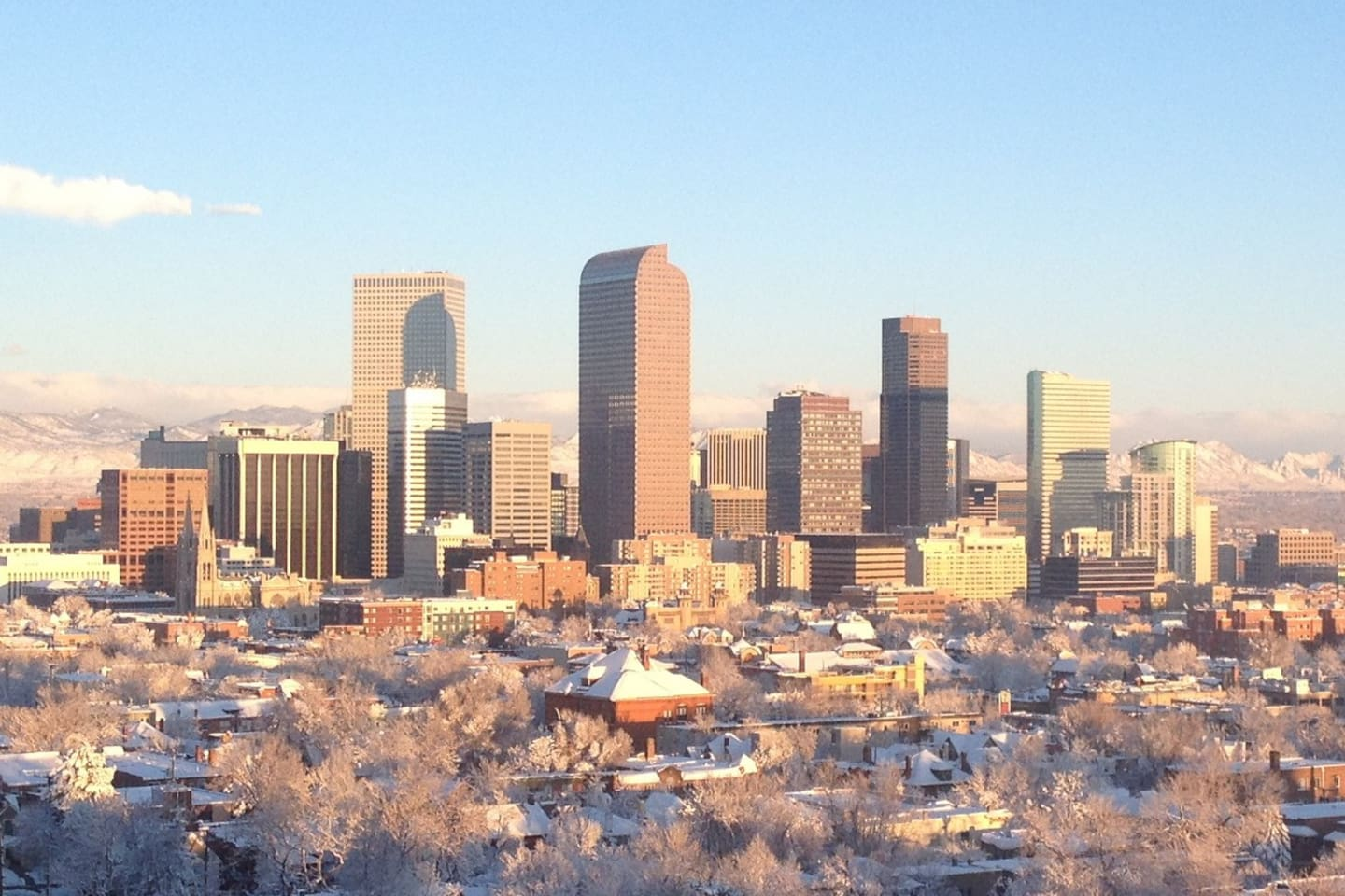 Welcome to the City of Denver! Denver's beautiful skyline with the mountains in the background.