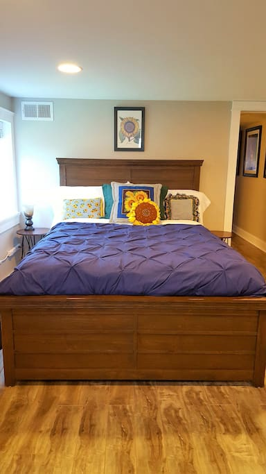 The bed is queen sized with a pillow top mattress. There are two king sized pillows on the bed.  Both the pillows and comforter are polyester.  We have different sets of sheets and duvet covers, so the linens may not match the pictures.