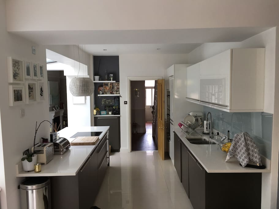 Modern kitchen with boiling water tap, cooker, oven, microwave, fridge/freezer, washing machine and dishwasher.