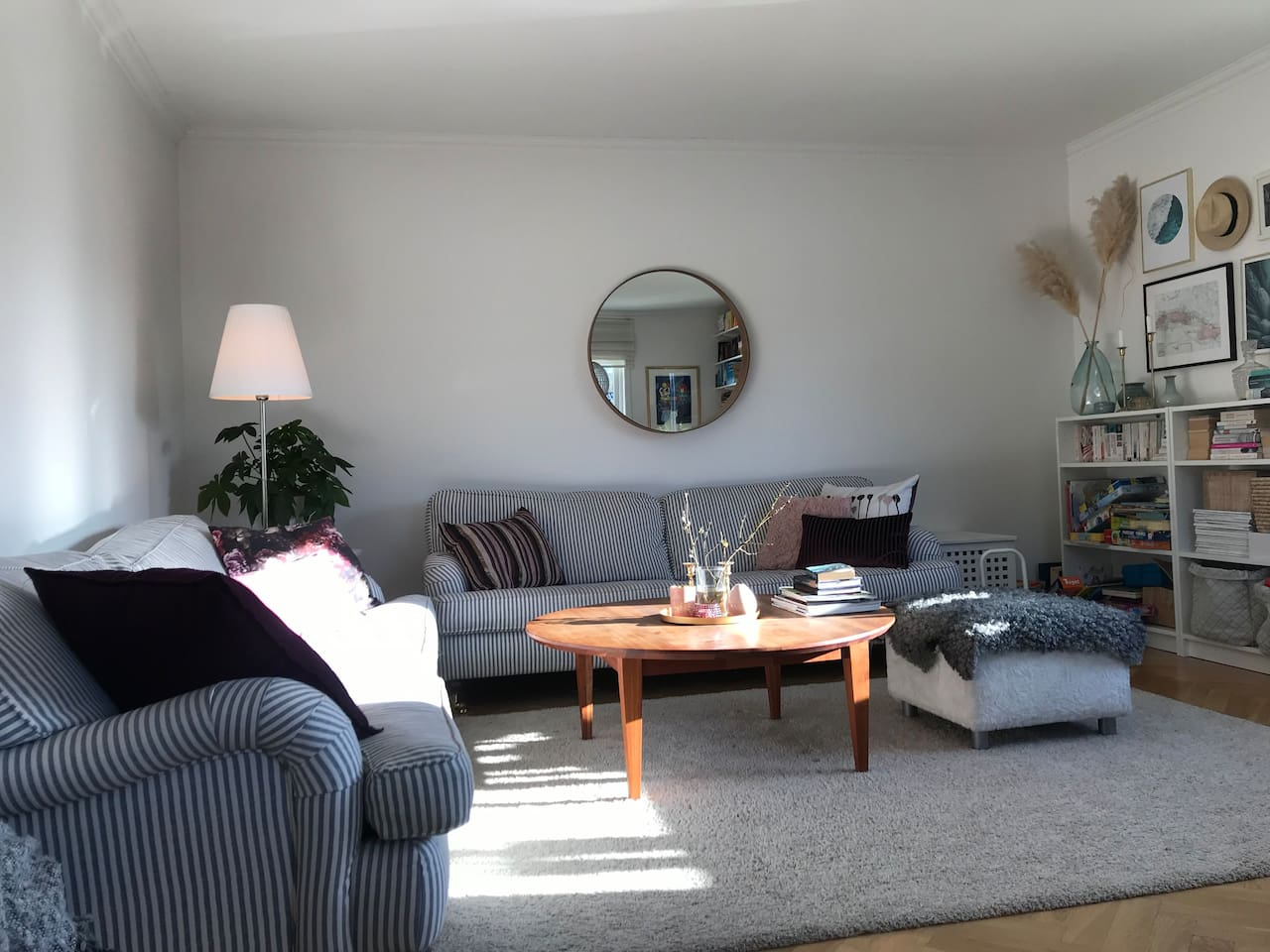 Living room with two sofas and a dinner table seating up to 10 people.
