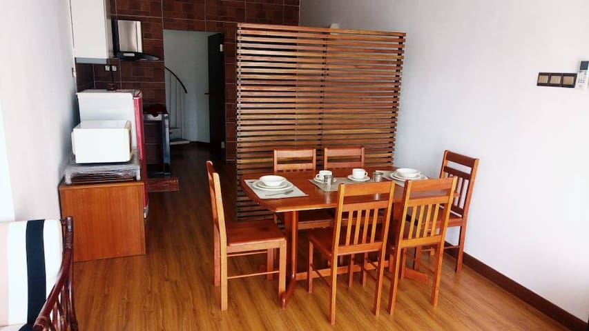 Warm and woody dining room .