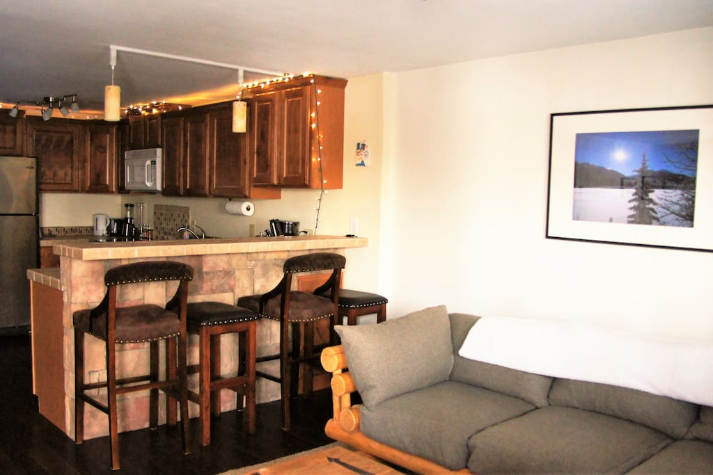 The lounge area leads into the kitchen with a breakfast bar with seating for four.