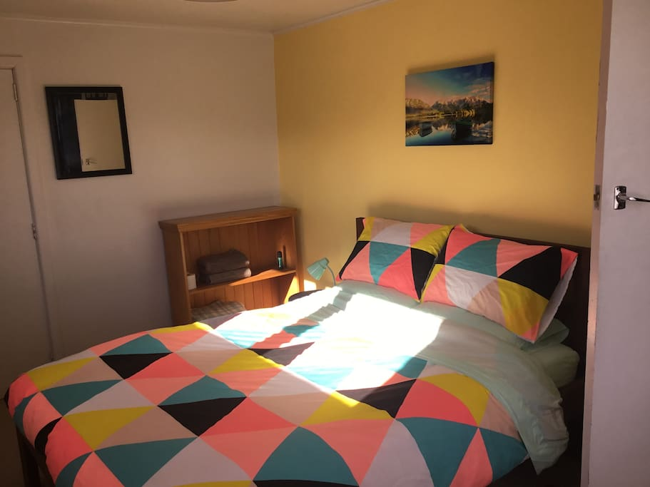 The sun pours in to the bedroom. Really comfortable queen bed with great mountain views.