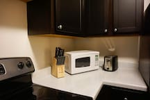 Knives, microwave, and toaster.