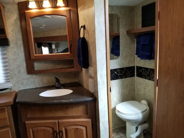 Bathroom sink and separate commode room.