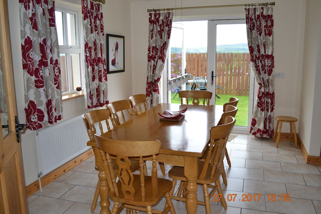Dining area (seats 8) with patio doors to fenced off rear garden