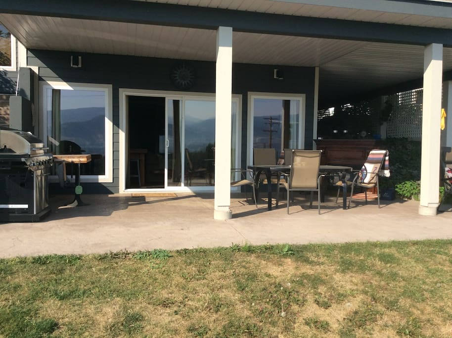 Your own private covered deck complete with propane BBQ, seating and dining area, loungers, and an electric fireplace for evening ambiance!