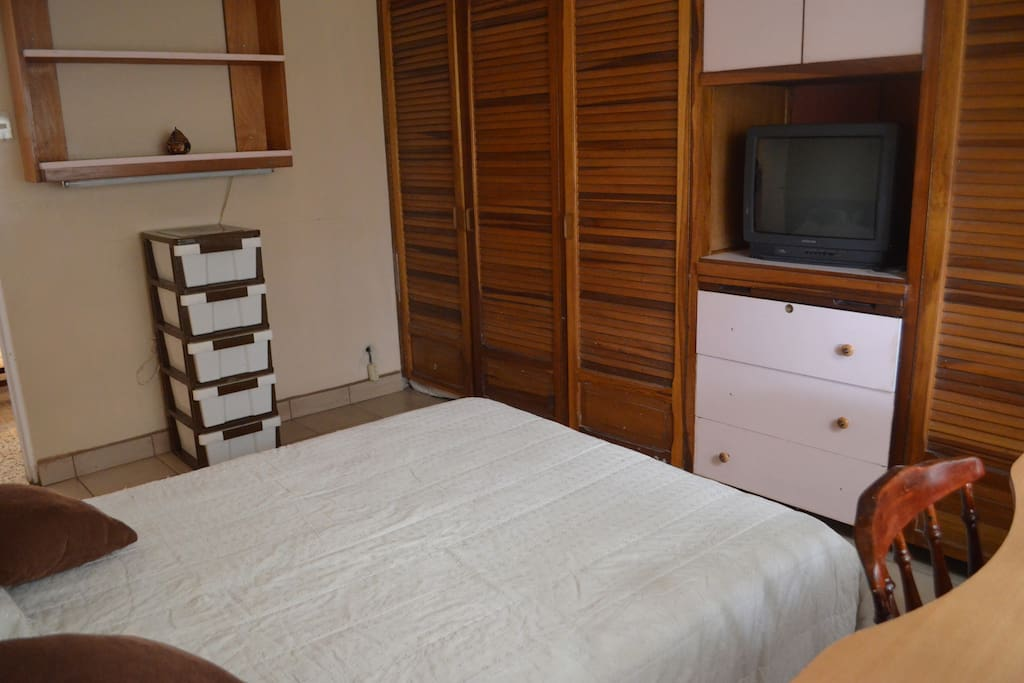 Well lit room with double bed and plenty of closet space.  TV with cable inside the room.