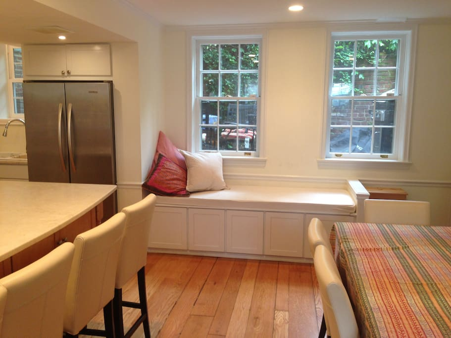 Newly renovated kitchen with day bed.