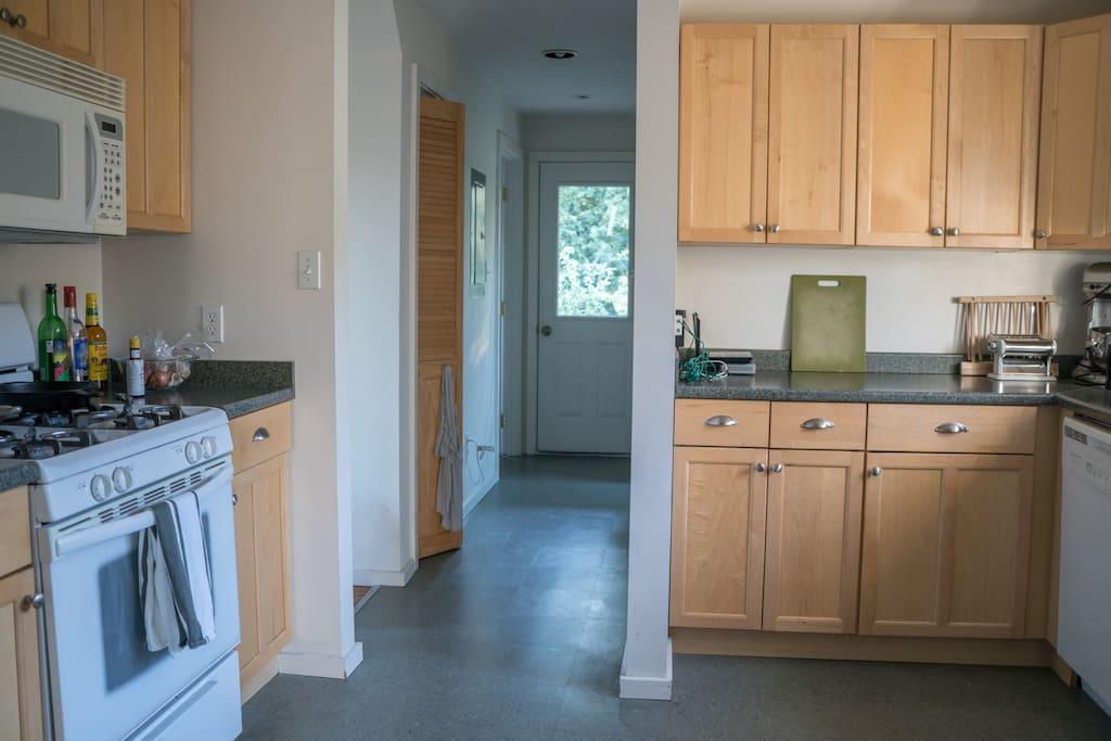 Full use kitchen with gas range and dishwasher
