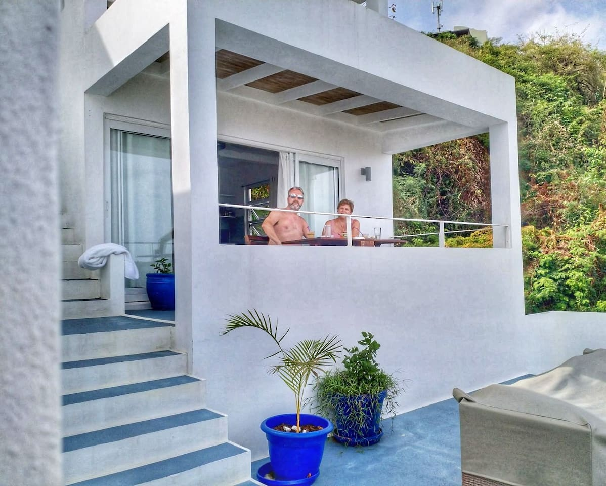 Happy guests on balcony of Sky Blue Apartment on the middle floor