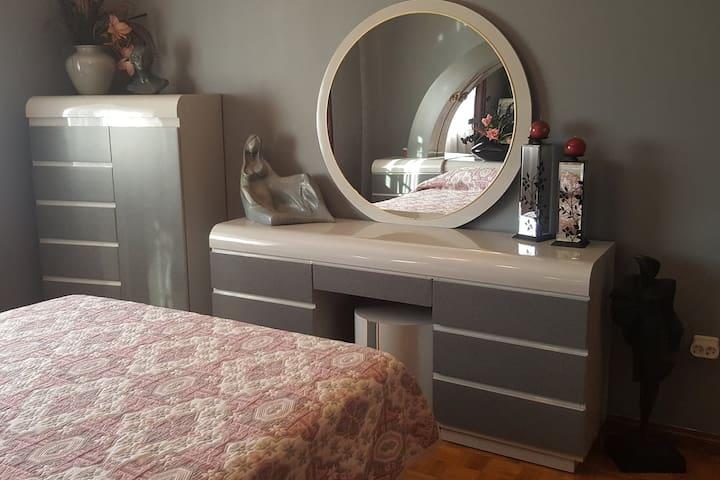 Bedroom number 2 with a queen bed