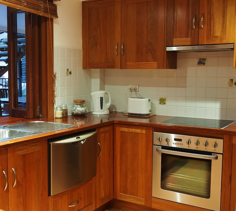 Rosewood kitchen with all modern ammenities.