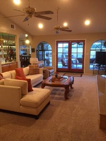 "Living Room with wetbar, 55"" Smart TV, Gas fireplace, direct access through french doors to covered patio"