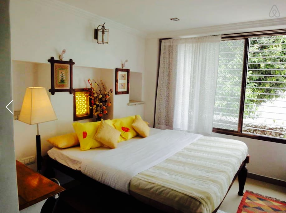 Spacious Bedroom with Big sliding  Window with full view of the Lake..