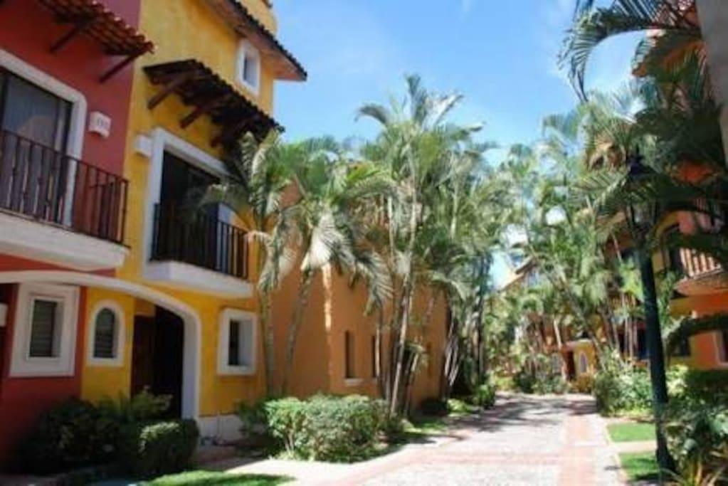 Located in the prestigious gated community of Isla Iguana beautiful lush manicured grounds