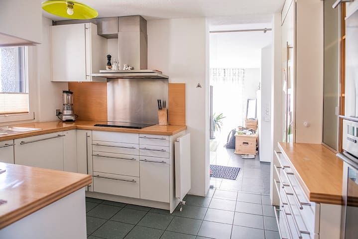 Shared kitchen with owner, all utensils available for use.