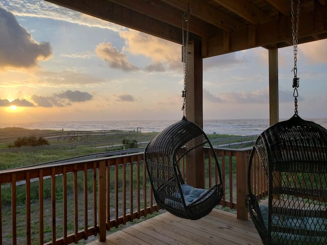 Enjoy the beach breeze while swinging in the two hanging chairs that overlook the ocean.