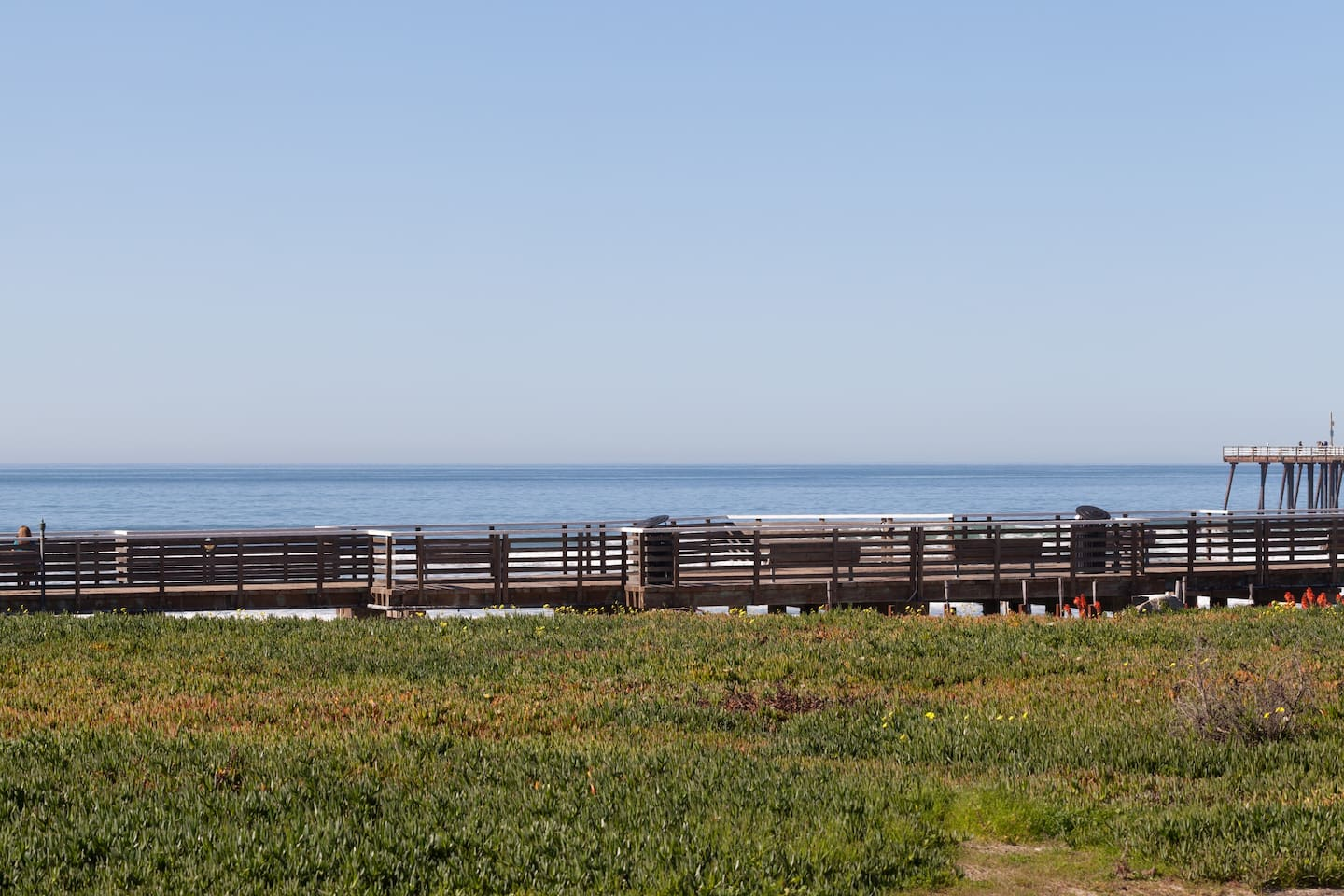 """Pismo Beach """"BOARDWALK""""  is about 200 feet to the Front Door of our beach house. The home is a few steps away from Pismo Beach Sand. You can hear the waves crashing upon the shore as you bask in the sun on the front porch. A great place to call home."""