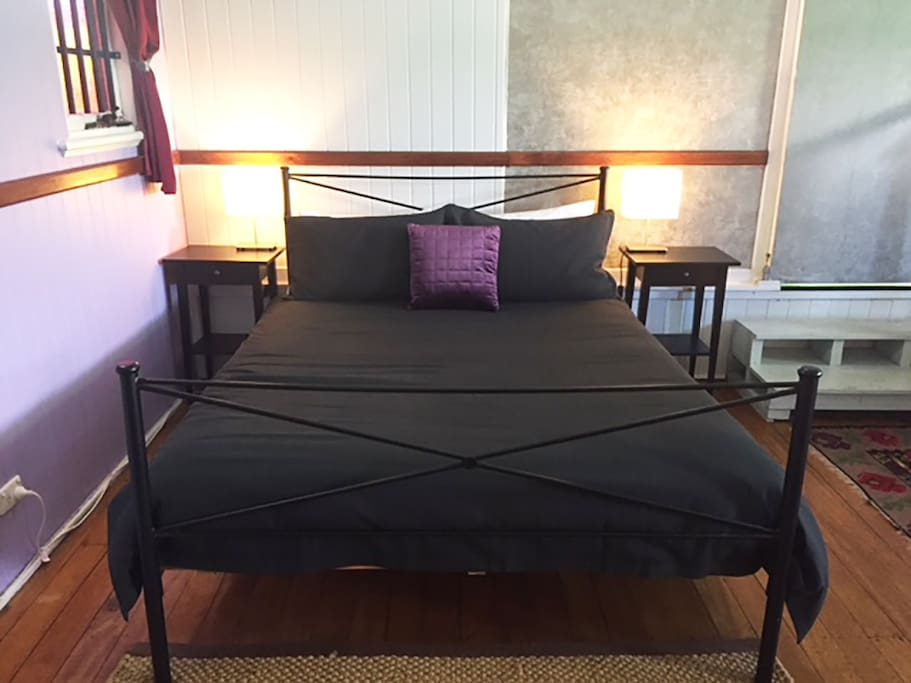 Comfortable queen bed with mattress topper.