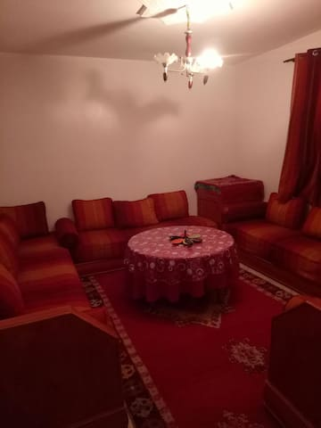 Nice Moroccan living room decorated with a handmade carpet by the Moroccan woman from south atlas