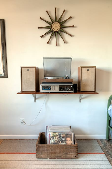 Vintage turntable and curated selection of vinyl records to play