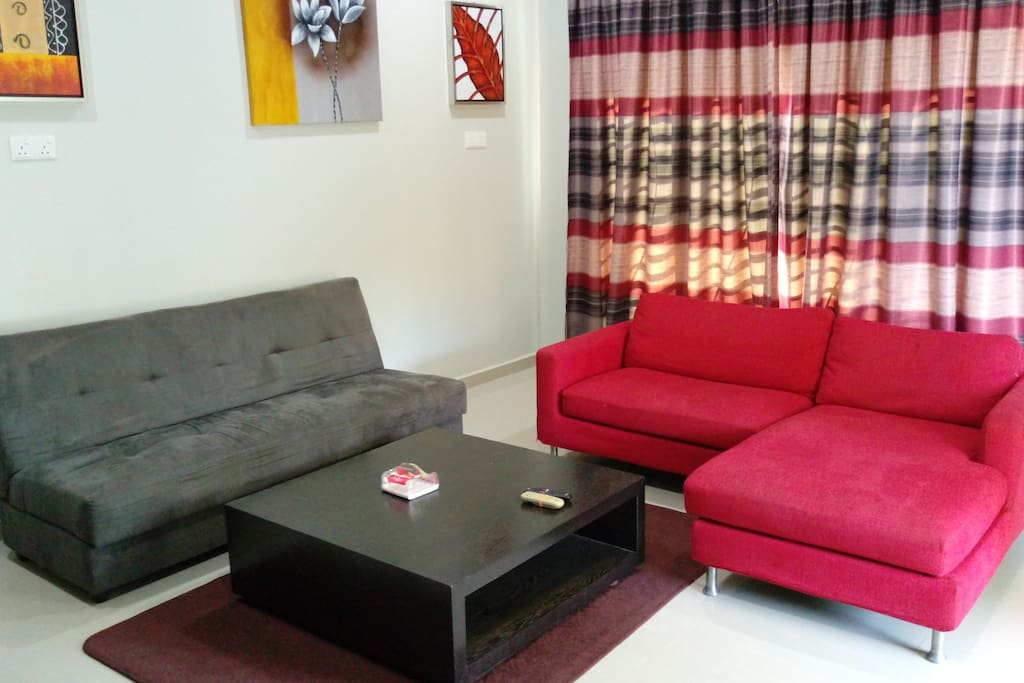 2 sofa set with coffee table, TV, Astro and free WiFi.
