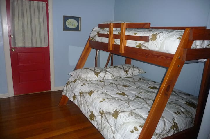 Sleeping room with double bed on bottom and twin bed on top