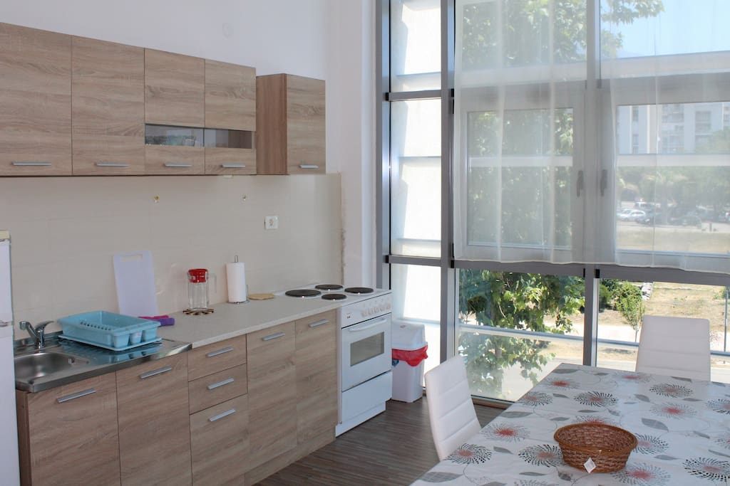 Kitchen is right next to the dinning table which makes it very convenient and it has these huge windows for ventilation.