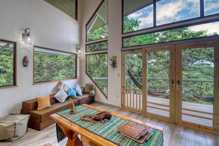 Luxury treehouse w/ a full kitchen, furnished balconies, & amazing views