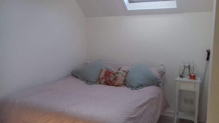 Room with double bed, desk and wardrobe - Bishops Cleeve