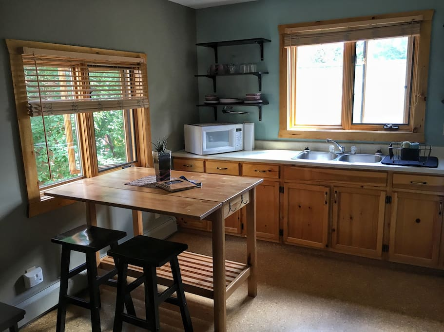 Kitchen fully supplied for cooking and dining