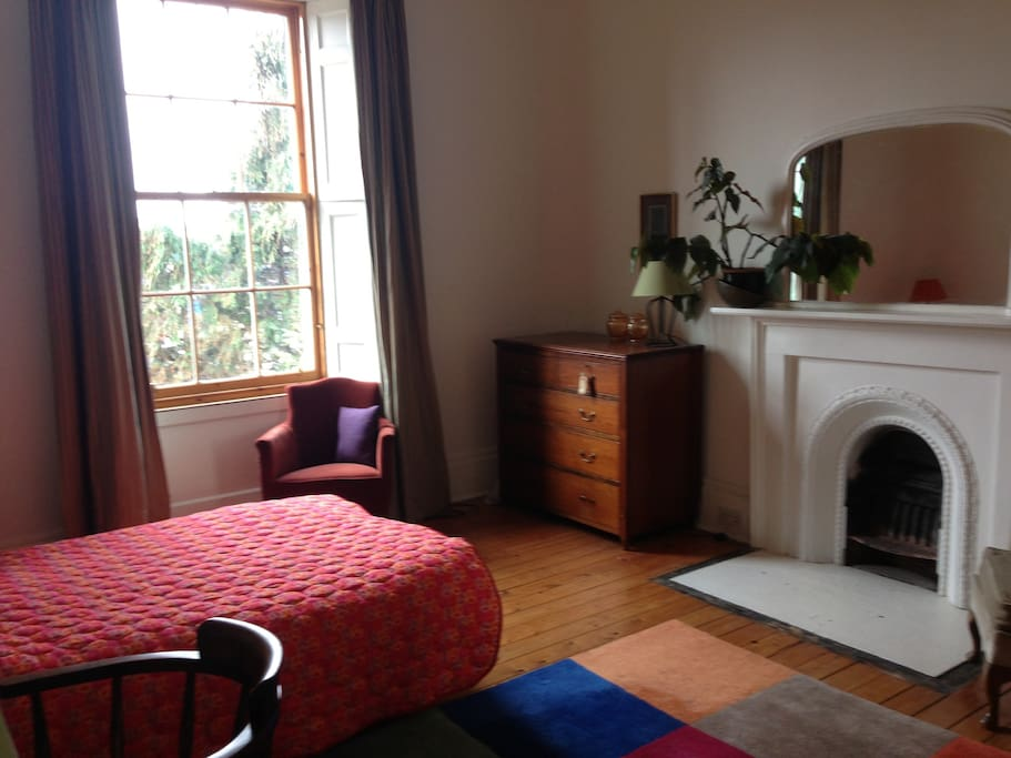 Double bedroom, light and comfortable, with views over Arthurs Seat and old town/city beyond....