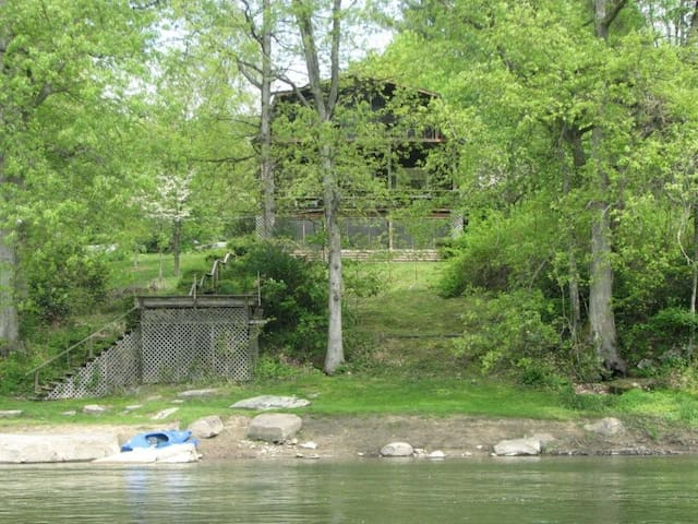 View from river - 3 levels with deck & porches & river deck!