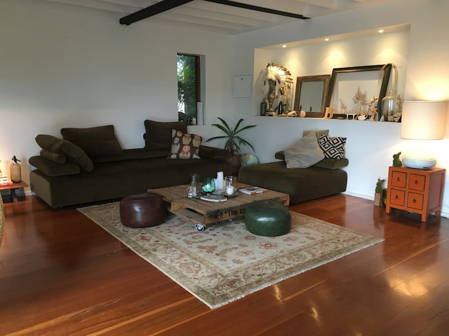 Open plan living, plenty of space & views over Pittwater and tropical palms