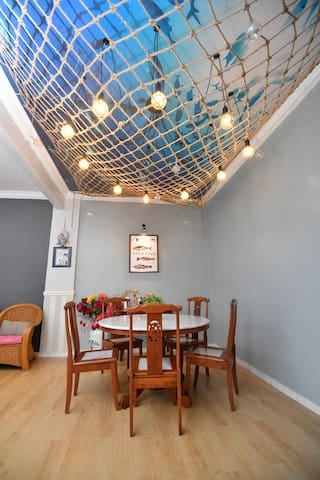 Dining Table with fishing net decorations!