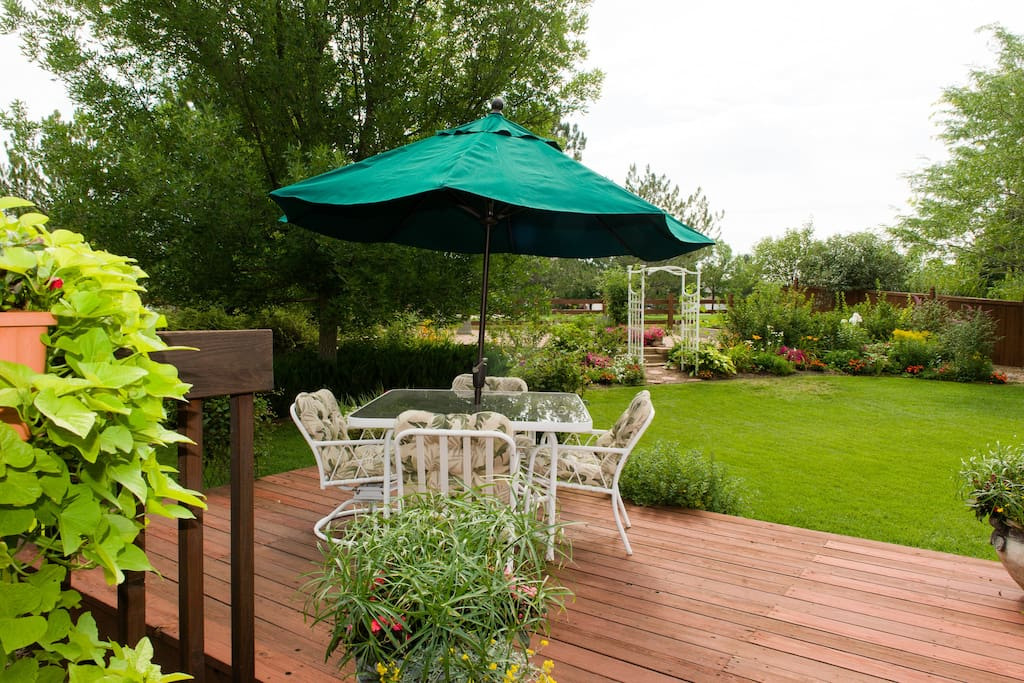 In our backyard, you may sit on our deck or patio to enjoy the 300+ days of Colorado sunshine