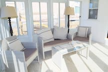The seating area in the sun room.