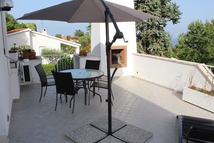 Monolocale con terrazzo vista mare - Villaggio Taunus - Appartement