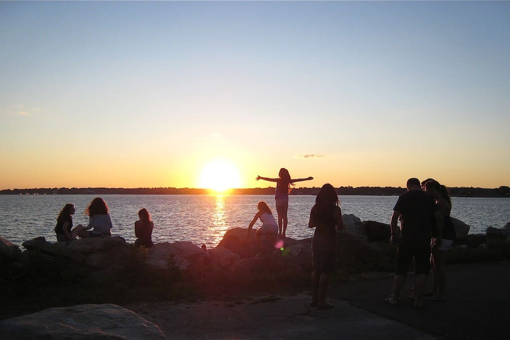 SUNSET WORSHIPERS AT GREENWICH POINT.