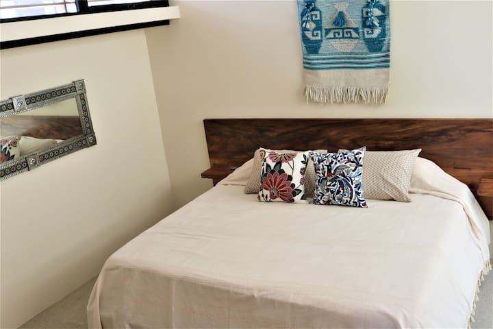 Master bedroom has a king size bed and air conditioning.  Plenty of light and closet space.