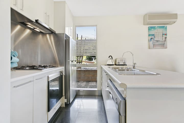 Kitchen has all amenities including a brand new dishwasher.