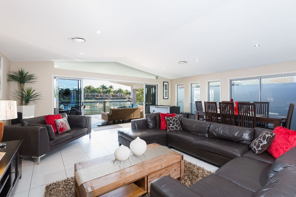 Large open plan Living leading directly to the huge covered deck and River mainriverabode