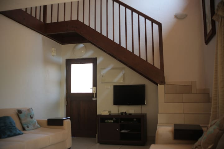 Stairway leading to the upstairs bedrooms.